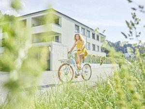 Young woman riding bicycle - CVF00805