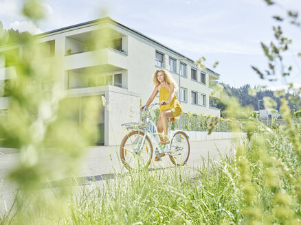 Young woman riding bicycle - CVF00805