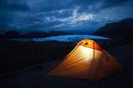 USA, Alaska, illuniated tent at Matanuska Glacier - CVF00814