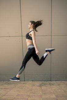 Sportive woman jumping - ACPF00030