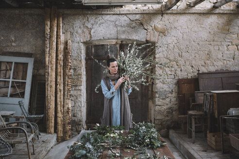 Woman arranging twigs - ALBF00480