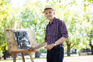 Senior man drawing in park, Hackney, London - CUF31954