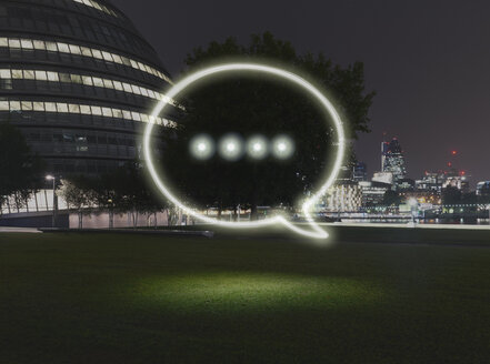 Glowing speech bubble symbol in city at night - CUF32371