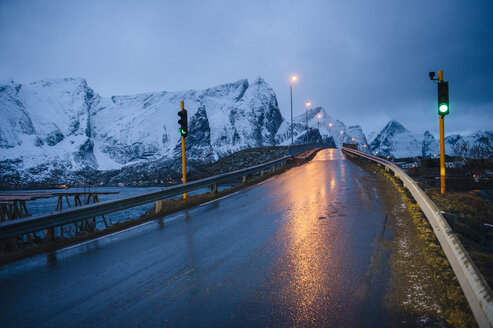 Wet highway and green light at dusk, Reine, Lofoten, Norway - ISF09822