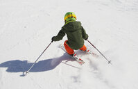 Young boy skiing downhill, rear view - ISF09891
