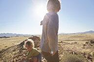Boys playing in desert, Walvis Bay, Namib-Naukluft National Park, Namibia - ISF09963