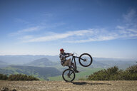 Cyclist pivoting on back wheel, San Luis Obispo, California, United States of America - ISF10146