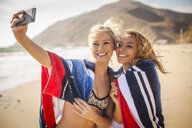 Girlfriends taking selfie on beach, Malibu, California, USA - ISF10254