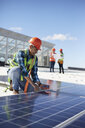 Engineer testing solar panel at power plant - CAIF20748