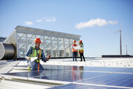 Engineer testing solar panels at sunny power plant - CAIF20751