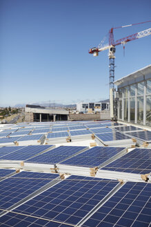 Solar panels stacked on sunny rooftop - CAIF20805