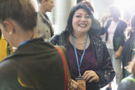 Portrait smiling, enthusiastic woman at conference - CAIF20826