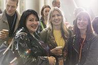 Portrait smiling, confident businesswomen at conference - CAIF20856
