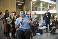 Audience clapping for male speaker in wheelchair - CAIF20865