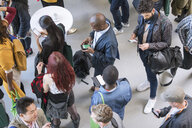 Business people using smart phones at conference - CAIF20880