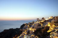 Oia town at sunset, Santorini, Cyclades Islands, Greece - CUF32759