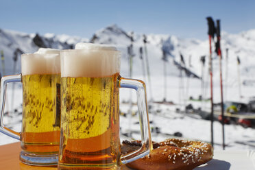 Two glasses of beer on outdoor cafe table, Austria - CUF32792