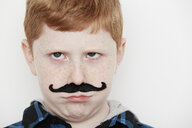 Boy wearing fake moustache, close up - ISF10511
