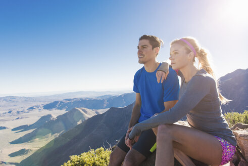 Trail running couple looking out at landscape on Pacific Crest Trail, Pine Valley, California, USA - ISF10589