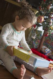 Little girl admiring Christmas gift - ISF10805