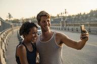 Joggers taking selfie on bridge, Arroyo Seco Park, Pasadena, California, USA - ISF11318