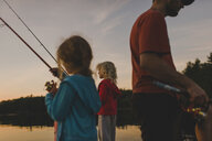 Father and daughters fishing, Kings Lake, Ontario, Canada - ISF11588