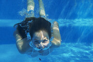 Underwater portrait of girl underwater swimming in swimming pool - ISF12344