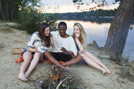 Friends camping by lake - ISF12632