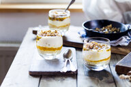 Unbaked cheesecake in a glass with passion fruit and nut brittle - SBDF03594