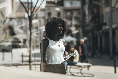 Woman with tablet in the city - OCAF00309