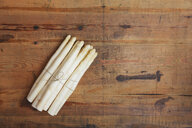 Bunch of white asparagus on wood, copy space - GWF05556