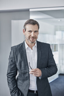 Portrait of confident businessman in office - RORF01293