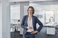 Portrait of smiling businesswoman in office - RORF01305