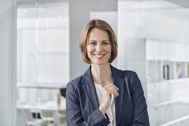 Portrait of smiling businesswoman in office - RORF01311