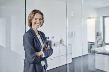 Portrait of smiling businesswoman in office - RORF01359