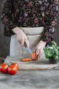 Woman preparing Caprese Salad, partial view - ALBF00516