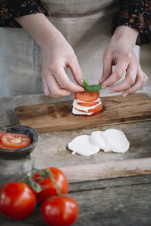Woman's hands preparing Caprese Salad - ALBF00522