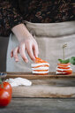 Woman's hands preparing Caprese Salad - ALBF00525