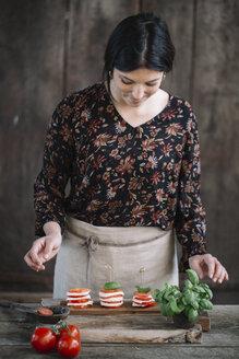 Woman preparing Caprese Salad - ALBF00531
