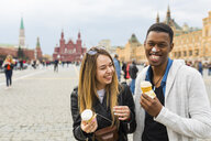 Russia, Moscow, couple eating icecream in the city - WPEF00429