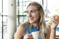 Young woman in cafe drinking coffee - UUF14252