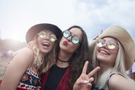 Portrait of three women having fun at the music festival - ABIF00604