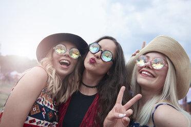 Portrait of three women having fun at the music festival - ABIF00604