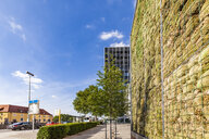 Germany, Stuttgart, wall with moss near bus station, air pollution control - WDF04693