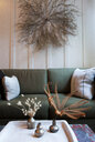 Sitting room with dried flower arrangements on wall and coffee table - ISF12787
