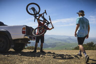 Cyclists preparing for mountain biking, San Luis Obispo, California, United States of America - ISF12793