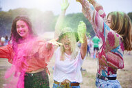 Portrait of friends at music festival, colour powder - ABIF00615