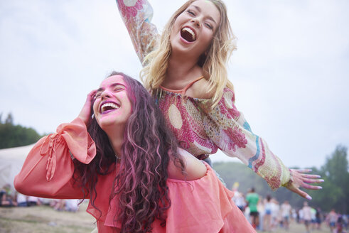 Playful friends having fun at the music festival - ABIF00621