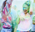 Friends dancing at music festival, holi powder - ABIF00633