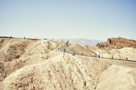 View of tourists on winding road, Zabriskie Point, Death Valley, California, USA - ISF13024